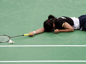 Taiwan`s Tai Tzu-ying reacts after losing a women`s singles badminton match against China`s Li Xuerui at the 2012 Summer Olympics in London.