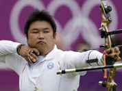 South Korea`s Oh Jin-hyek shoots during an elimination round of the individual archery competition at the 2012 Summer Olympics in London.
