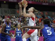 Canada`s Lizanne Murphy drives past France`s Endene Miyem during a women`s basketball game at the 2012 Summer Olympics in London.