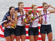 U.S. rowers Adrienne Martelli, Megan Kalmoe, Kara Kohler, and Natalie Dell display the bronze medals they won in the women`s rowing quadruple sculls in Eton Dorney, near Windsor, England, at the 2012 Summer Olympics.