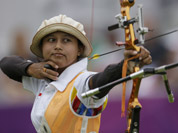 Indonesia`s Ika Yuliana Rochmawati shoots during an elimination round of the individual archery competition at the 2012 Summer Olympics in London.