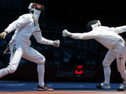 Hungary`s Geza Imre, left, competes with Morocco`s Abdelkarim El Haouari during men`s individual epee fencing at the 2012 Summer Olympics in London. 