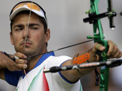 Italy`s Mauro Nespoli shoots during an elimination round of the individual archery competition at the 2012 Summer Olympics in London.