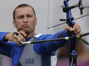 Ukraine`s Viktor Ruban shoots during an elimination round of the individual archery competition at the 2012 Summer Olympics in London.