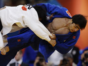 Masashi Nishiyama of Japan, left, and Chingiz Mamedov of Kyrgyzstan, compete during the men`s 90-kg judo competition at the 2012 Summer Olympics in London.
