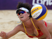 Xue Chen from China dives for a ball during the Beach Volleyball match against Greece at the 2012 Summer Olympics in London.