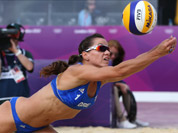 Maria Tsiartsiani from Greece reaches for a ball during the Beach Volleyball match against China at the 2012 Summer Olympics in London.