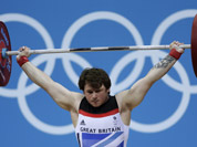 Great Britain`s Jack Oliver competes during the men`s 77-kg weightlifting competition at the 2012 Summer Olympics in London.