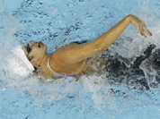 Syria`s Bayan Jumah competes in a women`s 100-meter freestyle swimming heat at the Aquatics Centre in the Olympic Park during the 2012 Summer Olympics in London.