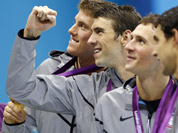 United States` Michael Phelps, center, pose with his gold medal after their win in the men`s 4 x 200-meter freestyle relay at the Aquatics Centre in the Olympic Park during the 2012 Summer Olympics in London.