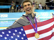 From left, United States` Michael Phelps, Conor Dwyer, Ricky Berens and Ryan Lochte pose with their gold medals for the men`s 4x200-meter freestyle relay swimming final at the Aquatics Centre in the Olympic Park during the 2012 Summer Olympics in London.