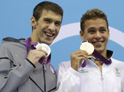 United States` Michael Phelps pose with his medal for the men`s 200-meter butterfly swimming final at the Aquatics Centre in the Olympic Park during the 2012 Summer Olympics in London.