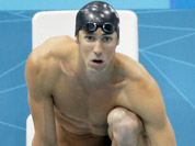United States` Michael Phelps waits to start the final leg of the men`s 4X200-meter freestyle relay as teammate Ryan Lochte, right, whistles to cheer on their teammate before their gold medal win at the Aquatics Centre in the Olympic Park during the 2012 Summer Olympics, London.