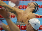 United States` Michael Phelps celebrates winning gold in the men`s 4x200-meter freestyle relay swimming final at the Aquatics Centre in the Olympic Park during the 2012 Summer Olympics in London.