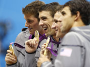 United States` Michael Phelps, center, pose with their gold medals after their win in the men`s 4 x 200-meter freestyle relay at the Aquatics Centre in the Olympic Park during the 2012 Summer Olympics in London.