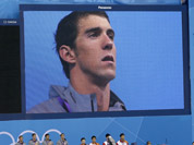 United States` Michael Phelps is seen on a large screen during a medal ceremony for the French, United States and Chinese men`s relay teams in the 4 x 200-meter freestyle relay at the Aquatics Centre in the Olympic Park during the 2012 Summer Olympics in London.