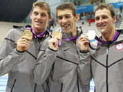 United States Michael Phelps, second from left, pose with his gold medal after their win in the men`s 4 x 200-meter freestyle relay at the Aquatics Centre in the Olympic Park during the 2012 Summer Olympics in London.