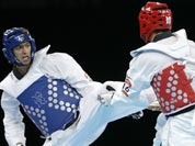 Azerbaijan`s Ramin Azizov fights United States` Steven Lopez (in red) during their match in men`s 80-kg taekwondo competition at the 2012 Summer Olympics.