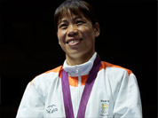 Bronze medalist, Chungneijang Mery Kom Hmangte, participates in the medals ceremony for women`s final flyweight 51-kg gold medal boxing match at the 2012 Summer Olympics.