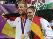 Germany`s Jonas Reckermann, left, and Julius Brink, right, pose for a photograph after winning the men`s gold medal beach volleyball match at the 2012 Summer Olympics.