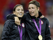 United States` Abby Wambach, right, and teammate Hope Solo celebrate winning the gold medal during in the women`s soccer final against Japan at the 2012 Summer Olympics.