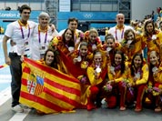 Members of the Spainsh water polo team pose with their silver medals after they were defeated by the United States in their women`s water polo gold medal match at the 2012 Summer Olympics.