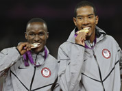 United States` gold medal winner Christian Taylor, is flanked by silver medal medal winner Will Claye, left, and bronze medal winner Fabrizio Donato from Italy during the ceremony for the men`s triple jump during the athletics in the Olympic Stadium at the 2012 Summer Olympics.