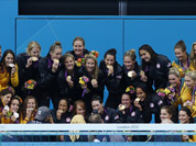 Members of the Spanish, left, United States and Australian women`s water polo team pose on the podium with their medals after following the women`s water polo gold medal match at the 2012 Summer Olympics.