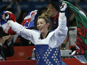 Britain`s Jade Jones celebrates after defeating China`s Hou Yuzhuo in their gold medal match in women`s 57-kg taekwondo competition at the 2012 Summer Olympics.