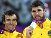 Brazil`s Alison, right, and Emanuel, left, display their silver medals after the men`s gold medal beach volleyball match at the 2012 Summer Olympics.