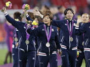 Japan soccer players celebrate winning the silver medal after being defeated in the women`s soccer final against the United States at the 2012 Summer Olympics.