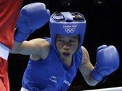 Mery Kom Hmangte, fights Tunisia`s Maroua Rahali in a women`s flyweight 51-kg quarterfinal boxing match at the 2012 Summer Olympics in London.