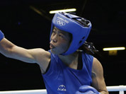 Mery Kom Hmangte, fights Tunisia`s Maroua Rahali during a women`s flyweight 51-kg quarterfinal boxing match at the 2012 Summer Olympics in London. 