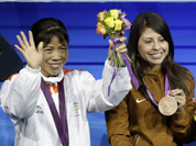 Bronze medalist, Mery Kom Hmangte, bronze medalist Marlen Esparza of the United States, gold medalist Nicola Adams of Great Britain, and silver medalist Ren Cancan of China participate in the medals ceremony for women`s final flyweight 51-kg gold medal boxing match at the 2012 Summer Olympics.