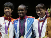 Silver medalist Ren Cancan, gold medalist Nicola Adams, bronze medalist, Mery Kom Hmangte, and bronze medalist Marlen Esparza, participate in the medals ceremony for women`s final flyweight 51-kg gold medal boxing match at the 2012 Summer Olympics in London.