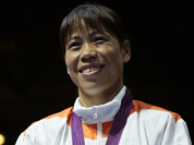 Bronze medalist, Mery Kom Hmangte, participates in the medals ceremony for women`s final flyweight 51-kg gold medal boxing match at the 2012 Summer Olympics in London. 