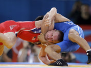 United States` Samuel Hazewinkel, red, and Kazakhstan`s Daulet Niyazbekov, blue compete during a 55-kg men`s freestyle wrestling competition at the 2012 Summer Olympics in London.