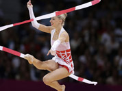 Austria`s Caroline Weber performs during the rhythmic gymnastics individual all-around qualifications at the 2012 Summer Olympics in London.