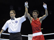 China`s Zou Shiming reacts after beating Ireland`s Paddy Barnes in a light flyweight 49-kg semifinal boxing match at the 2012 Summer Olympics in London.
