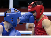 China`s Zou Shiming, fights Ireland`s Paddy Barnes, during their men`s semifinal light flyweight 49-kg boxing match at the 2012 Summer Olympics in London.