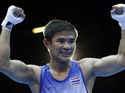 Thailand`s Kaeo Pongprayoon reacts after beating Russia`s David Ayrapetyan in their light flyweight 49-kg semifinal boxing match at the 2012 Summer Olympics in London.