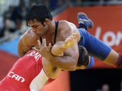 anada`s Matthew Judah Gentry, in red, and India`s Narsingh Pancham Yadav, in blue, compete during a 74-kg men`s freestyle wrestling competition at the 2012 Summer Olympics in London.