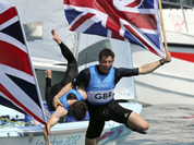 Luke Patience and Stuart Bithell of Great Britain celebrate their silver medal of the 470 men`s two person dinghy sailing race at the London 2012 Summer Olympics in Weymouth and Portland, England.