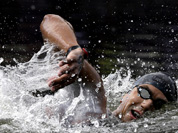 Tunisia`s Oussama Mellouli swims during the men`s 10-kilometer swimming marathon at the 2012 Summer Olympics in London.