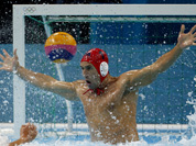 United States goalkeeper Merrill Moses is unable to stop a shot by Spain`s Felipe Perrone Rocha during a men`s semifinal fifth to eighth place water polo match at the 2012 Summer Olympics in London.