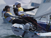 New Zealand`s crew Jo Aleh, left, and Olivia Powrie compete during the 470 women`s class medal race at the London 2012 Summer Olympics in Weymouth and Portland, England.