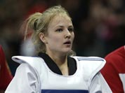Russia`s Anastasia`s Baryshinkova walks off the mat after fighting Tunisia`s Khaoula Ben Hamza in women`s plus 67-kg taekwondo competition at the 2012 Summer Olympics.