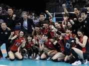 Japan poses for a photo after the team defeated South Korea during a women`s volleyball bronze medal match at the 2012 Summer Olympics.