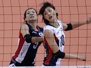 South Korea`s Kim Hae-ran, left, and teammate Kim Yeon-koung watch as a ball fall to the court during a women`s bronze medal volleyball match against Japan at the 2012 Summer Olympics.