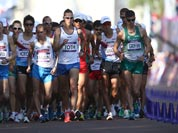 Athletes compete in the men`s 50-kilometer race walk at the 2012 Summer Olympics.